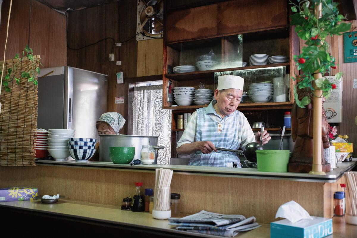an elderly Japanese chef in an old school Tokyo restaurant