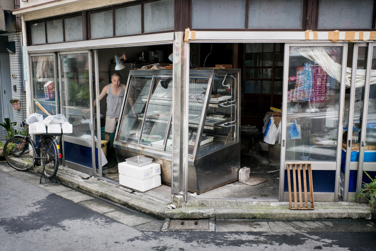 old fashioned Tokyo fish shop stares