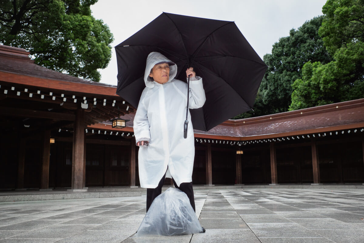 A Japanese man in a typhoon at Tokyo's Meiji Shrine