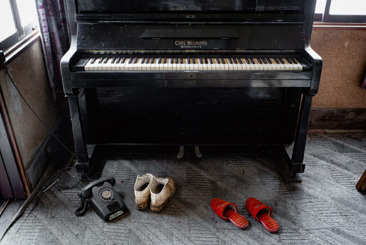a silent piano in an abandoned tokyo house