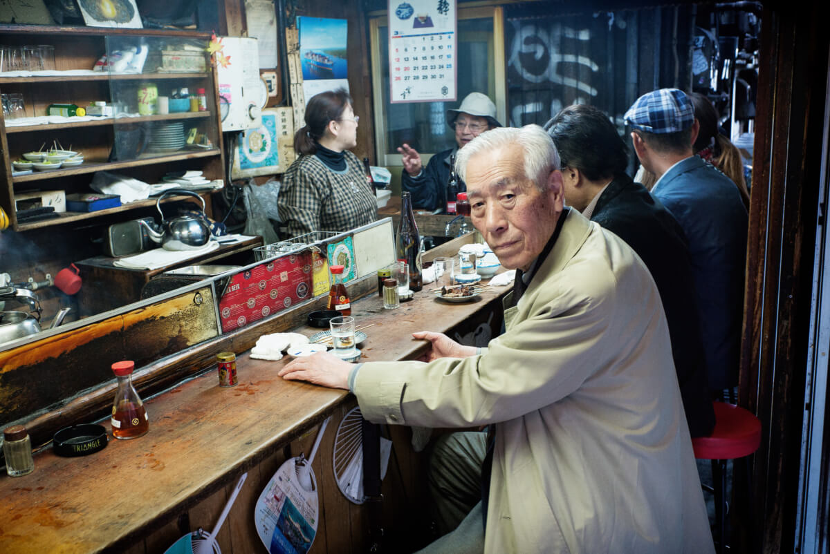 an old japanese drinker in an old bar