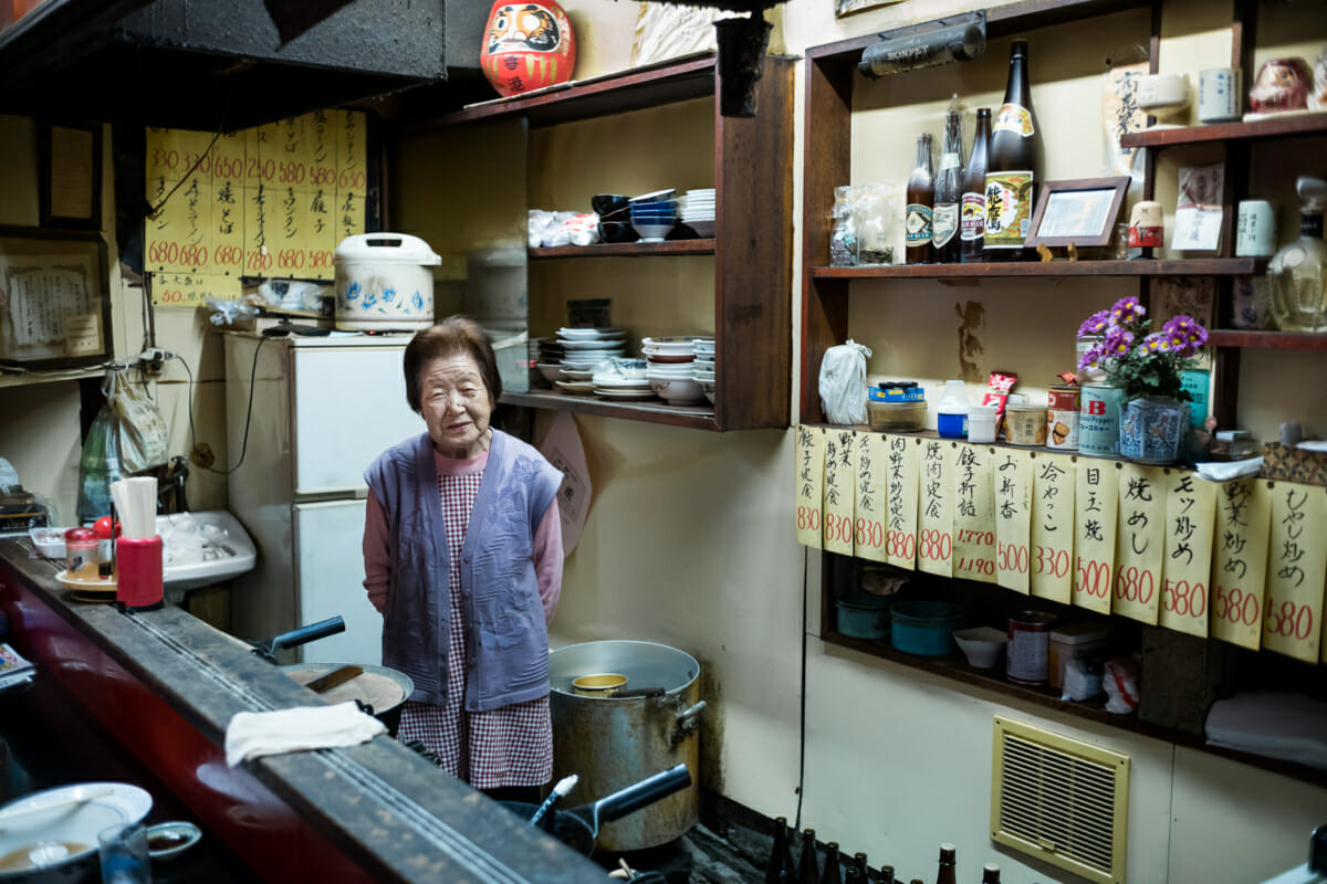 An elderly Japanese lady in her old ramen shop