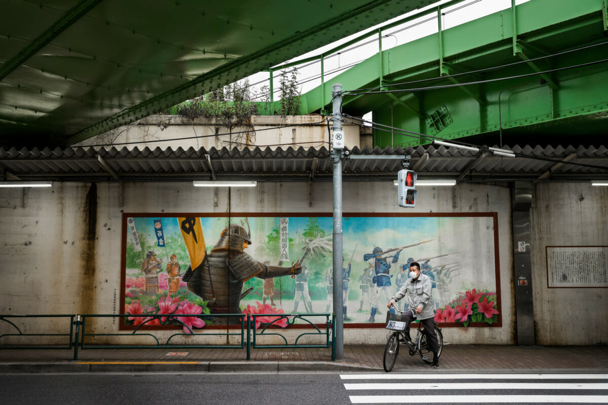 Ancient Tokyo gun squads, train tracks and traffic lights