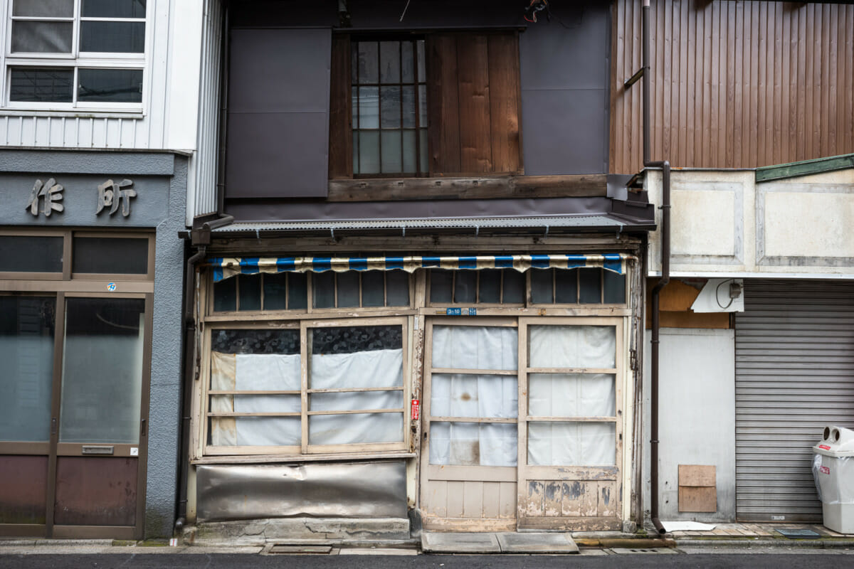 a crooked and askew old Tokyo tofu shop