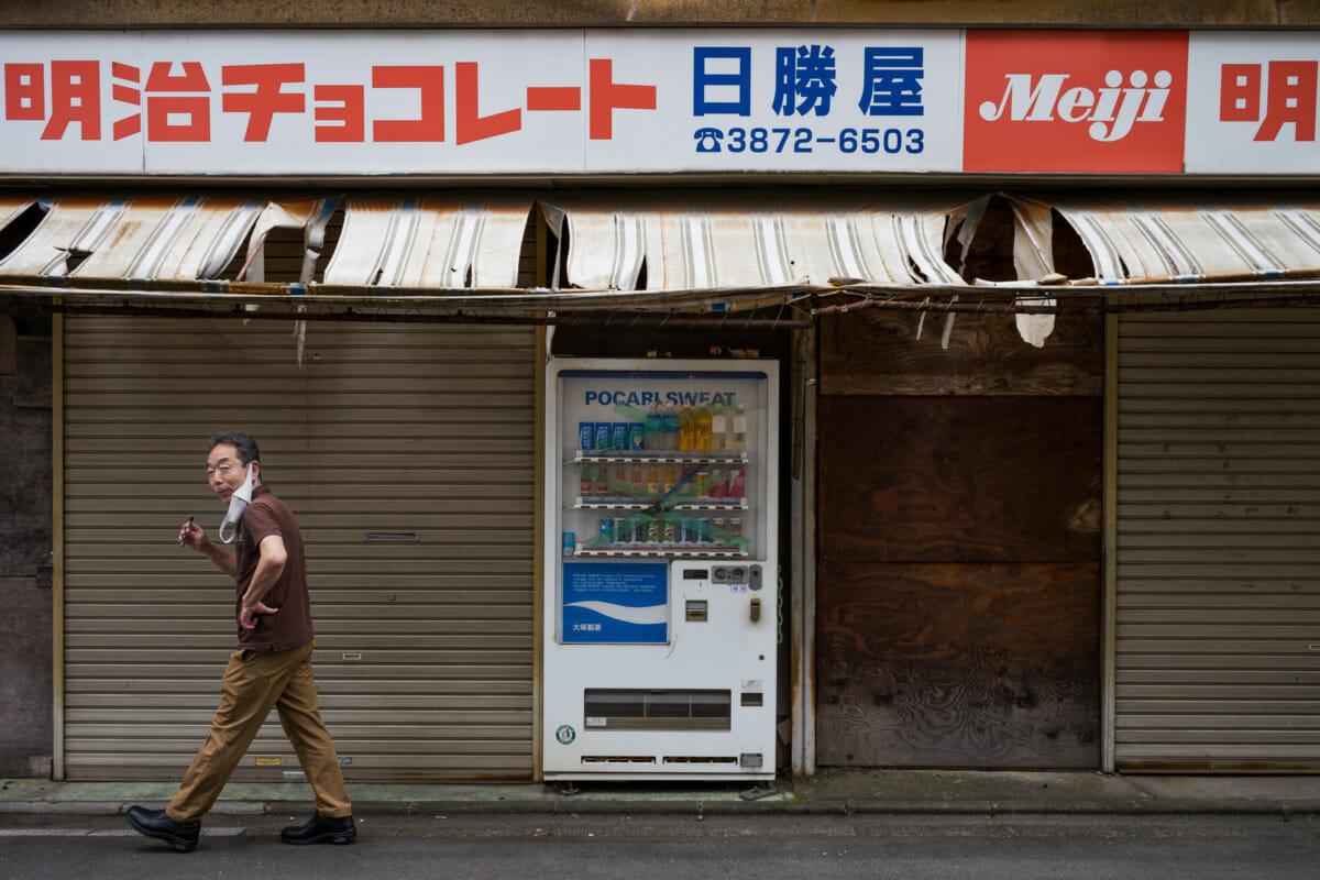 derelict Tokyo shop and a defunct vending machine