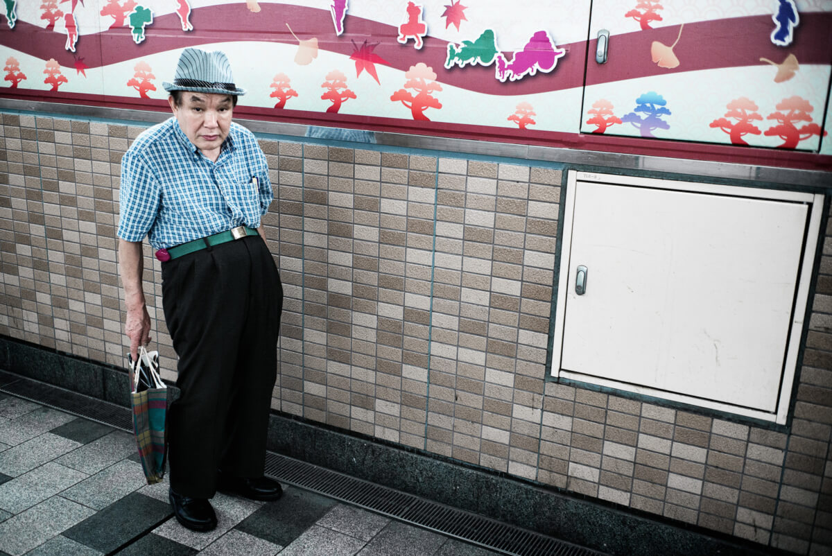 distinctive Japanese man in tokyo wearing a trilby