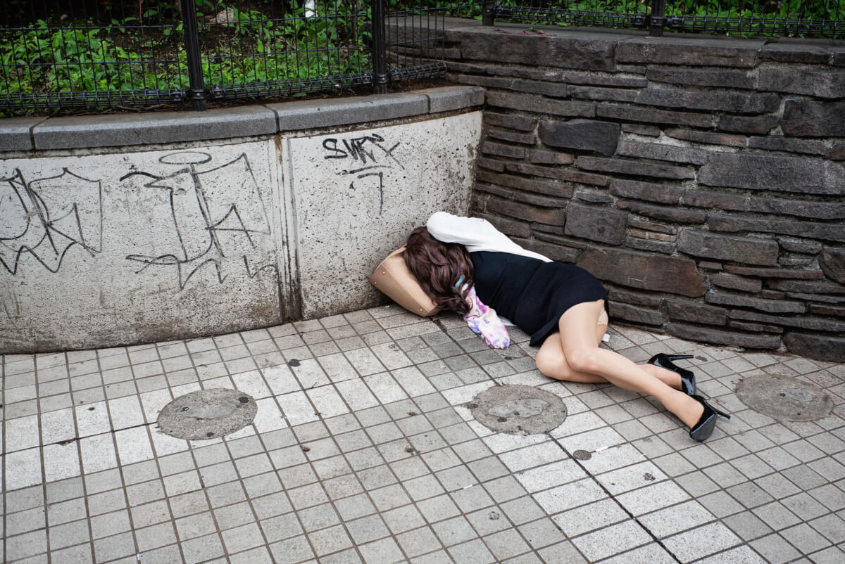 A Japanese transvestite drunk and asleep in Tokyo
