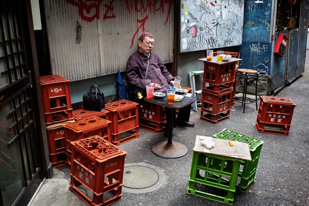 dejected looking Tokyo drinker