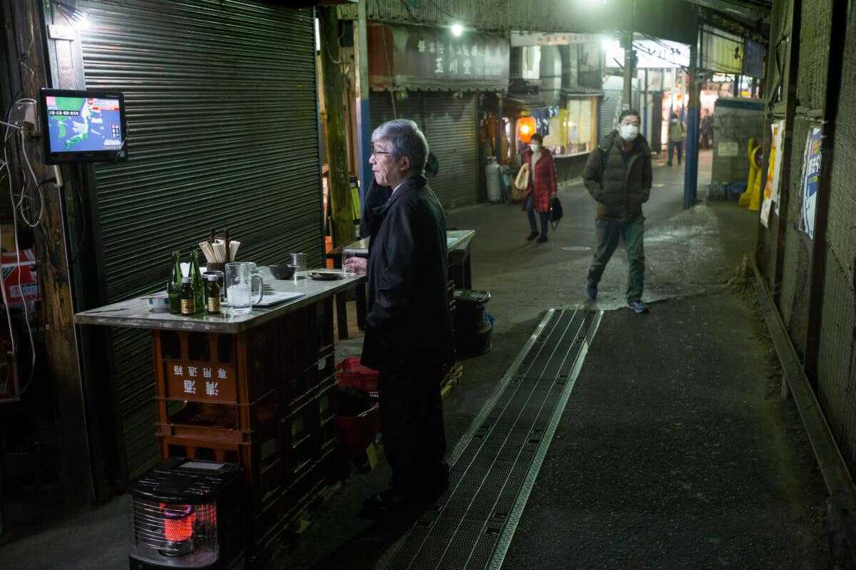 a dystopian Japanese drinking alleyway