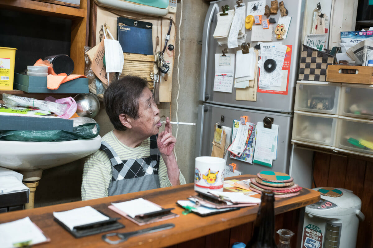 An elderly Tokyo bar owner and her enormous cat