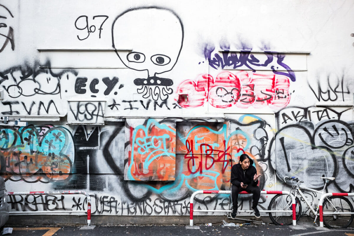 a graffiti covered wall in Tokyo