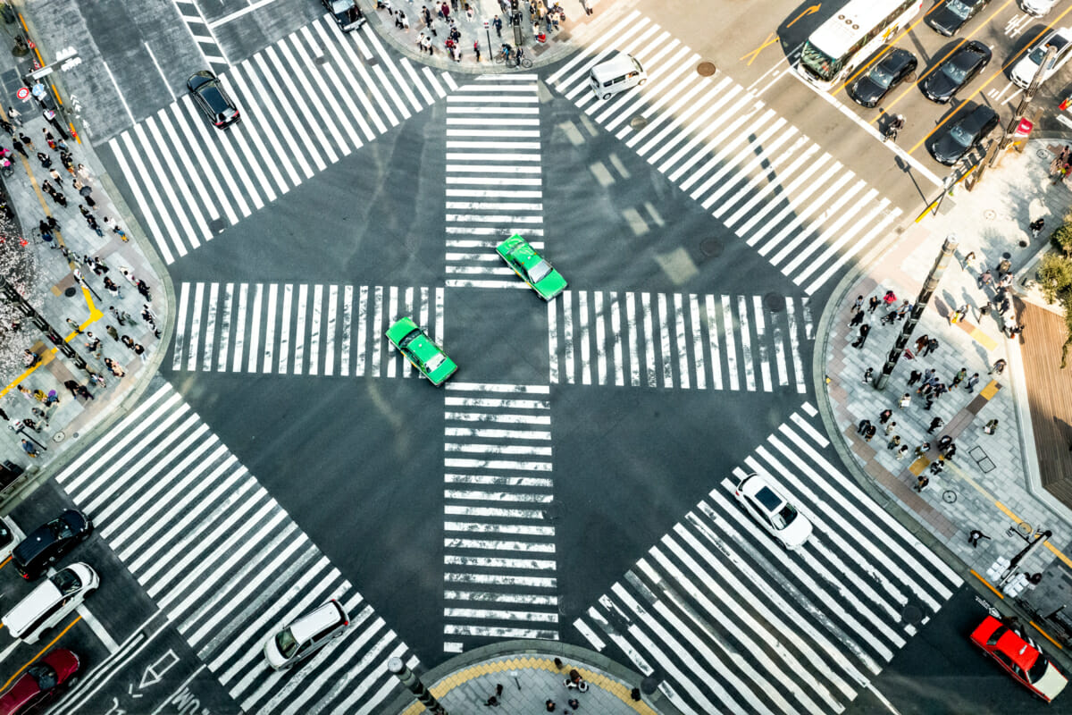 green taxis on a Tokyo crossing