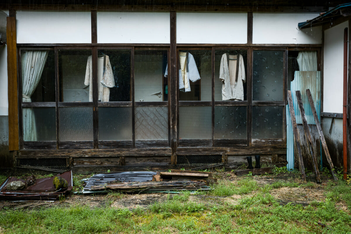 discarded clothes outside an abandoned Japanese home