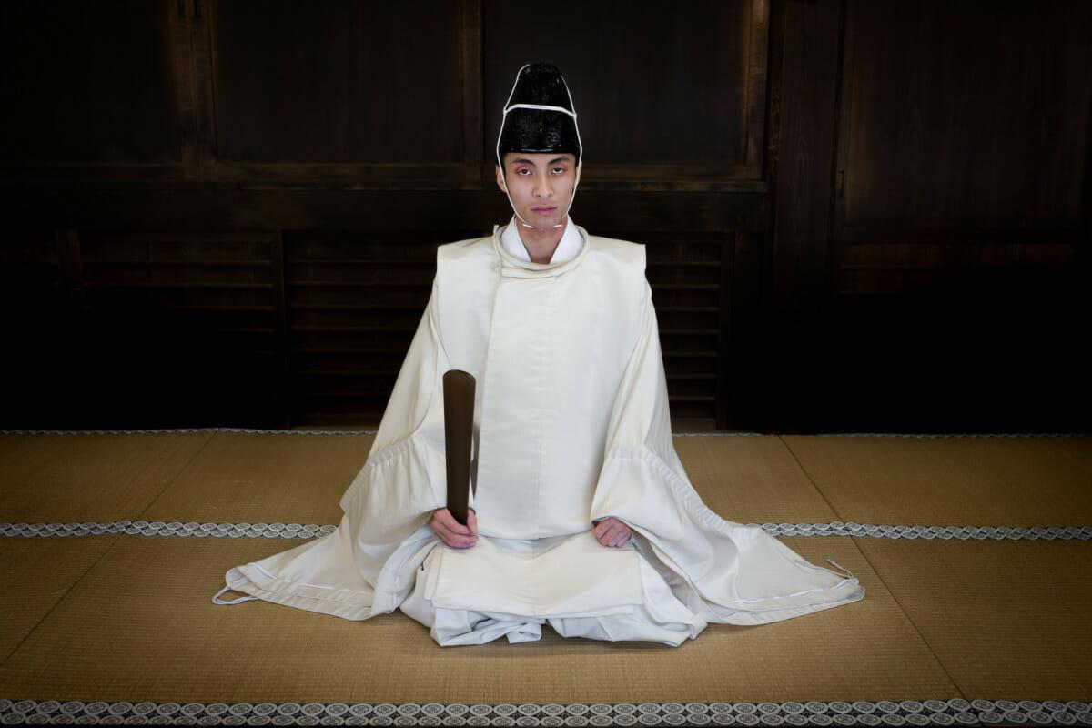 intense looking shinto priest in Tokyo
