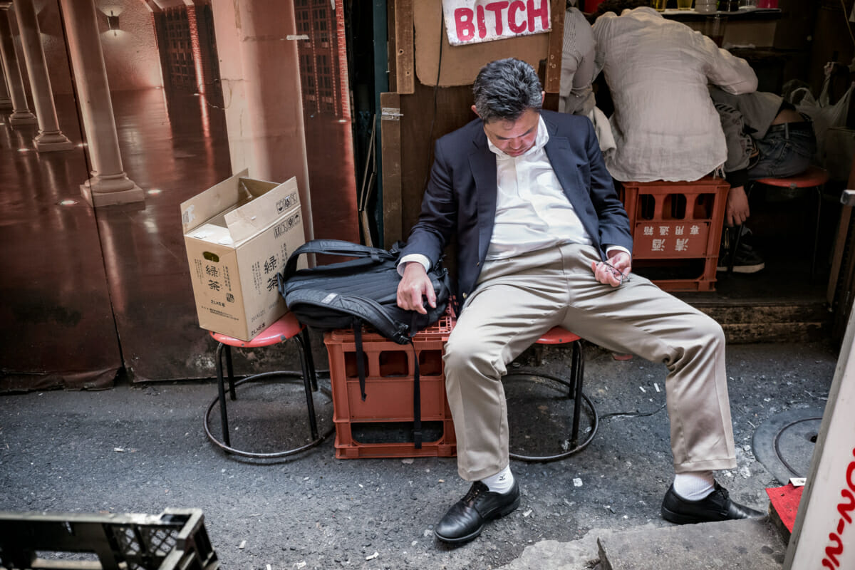 a Japanese drunk outside a very small Tokyo bar
