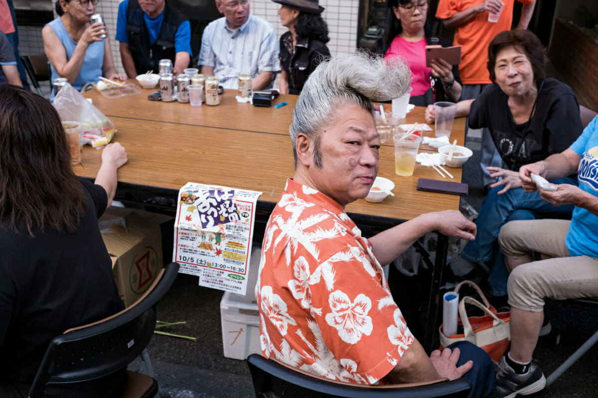 japanese man in tokyo with a huge quiff