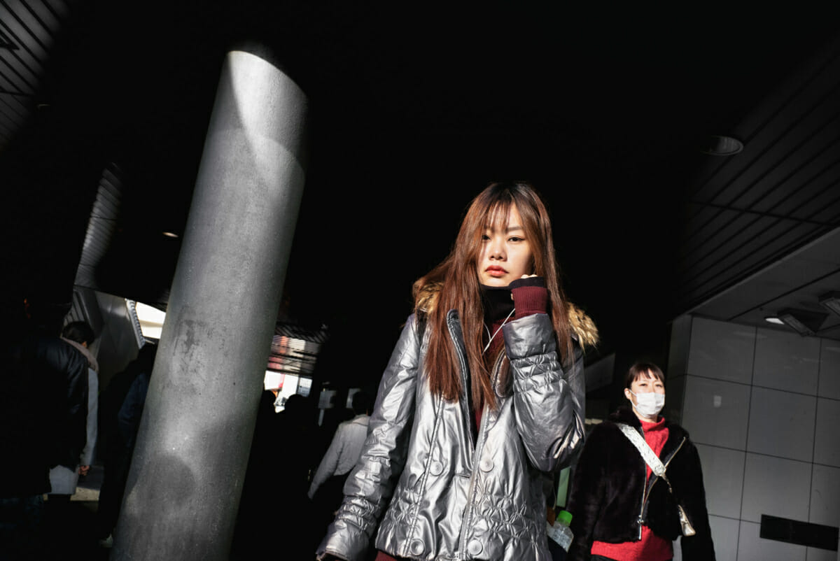 Japanese woman in silver in the shadows