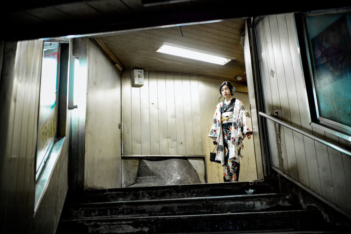 Japanese woman wearing a kimono in the subway