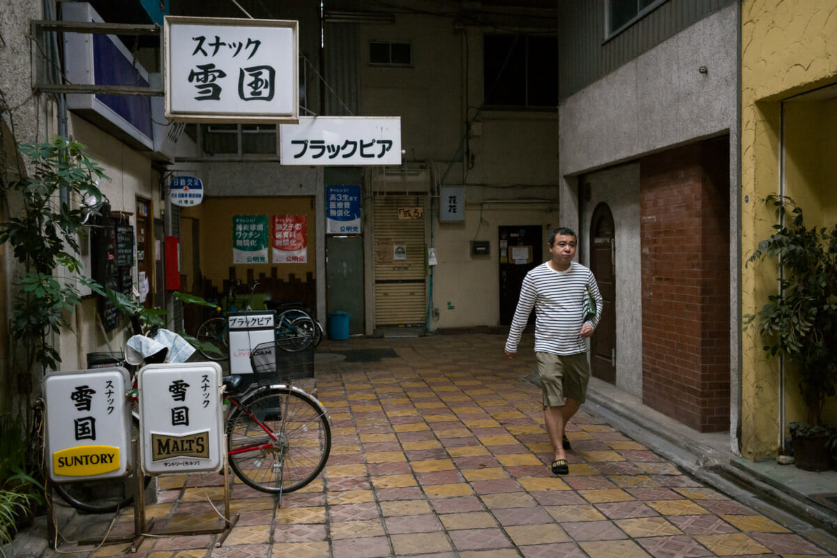 old and covered tokyo drinking arcade