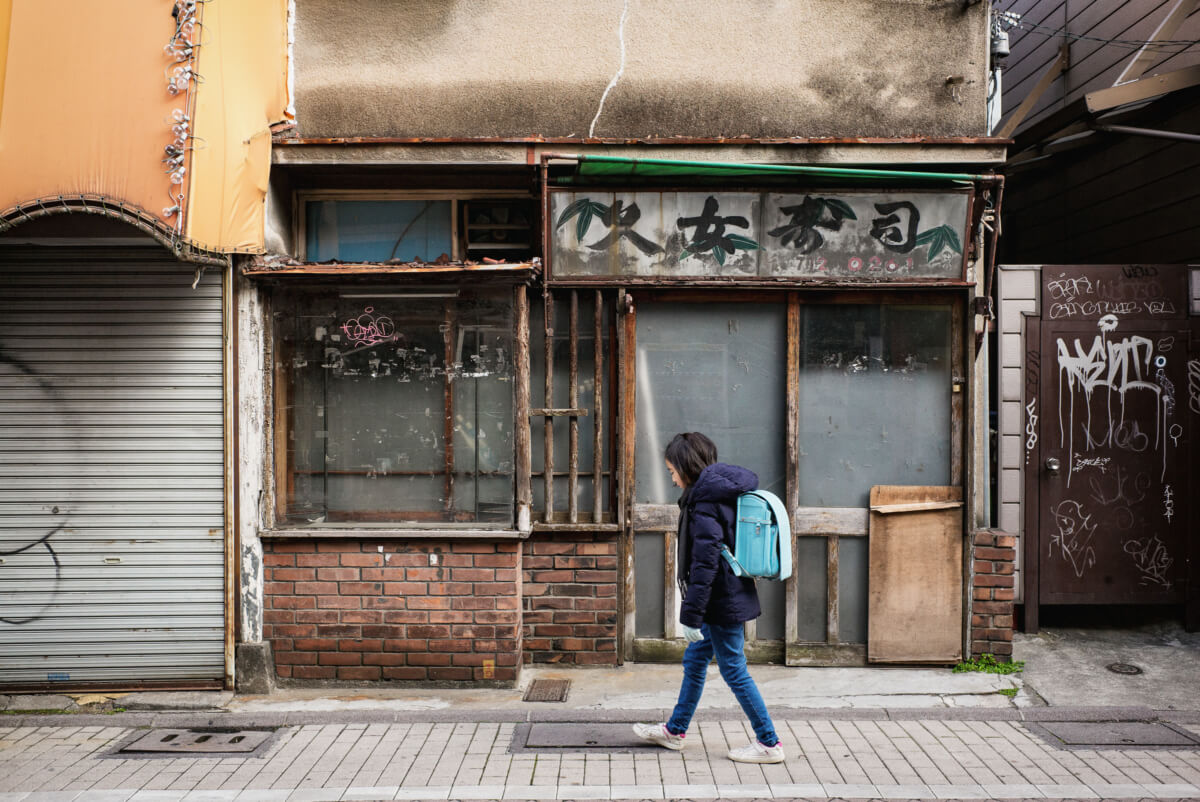 old faded and crumbling tokyo