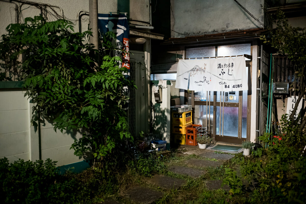 an old cluttered and interesting little Tokyo bar