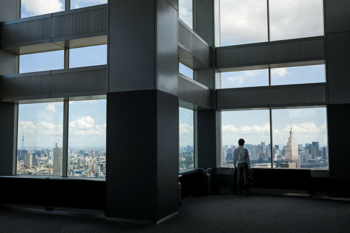 a man standing all alone in Tokyo