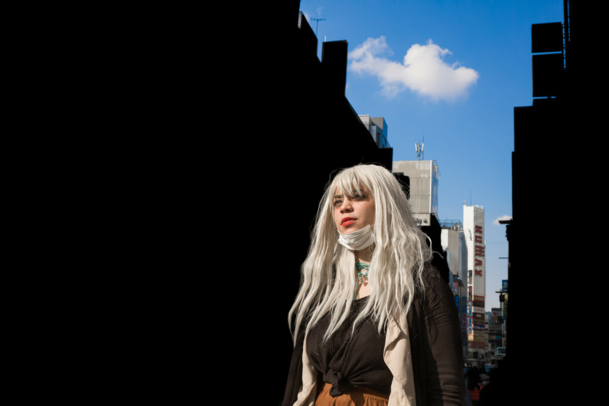 a striking young woman in striking Tokyo light