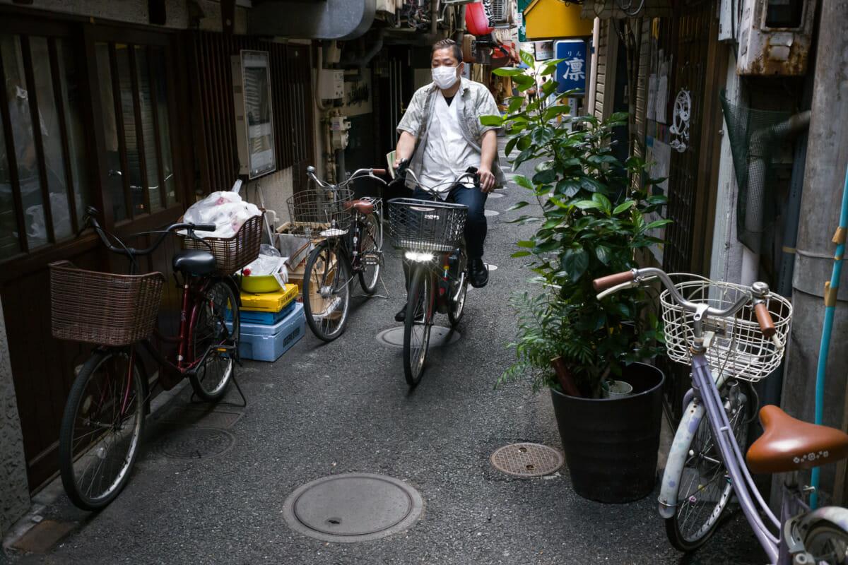 Tokyo alleyway bike rider