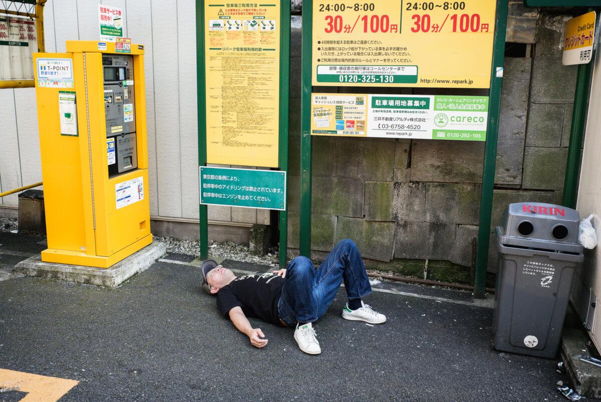 Japanese man drunk in a Tokyo car park