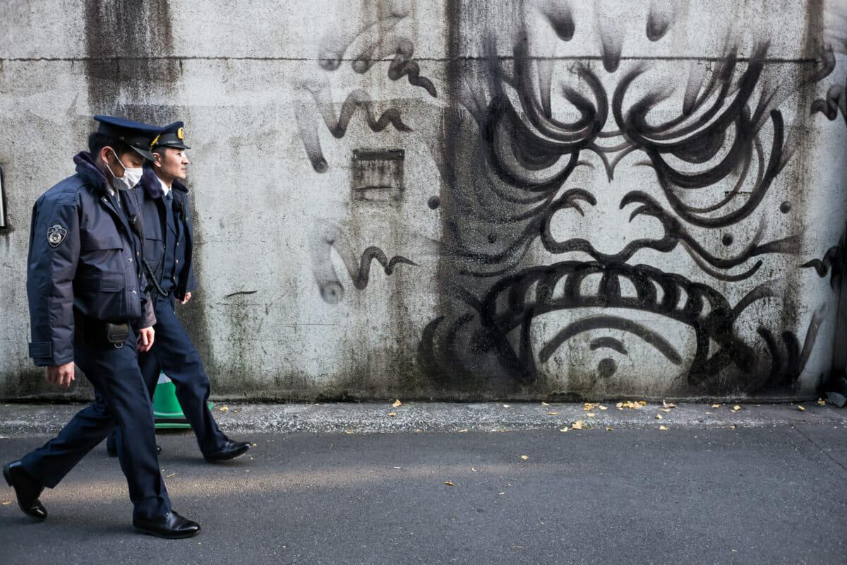 Tokyo police officers versus graffiti
