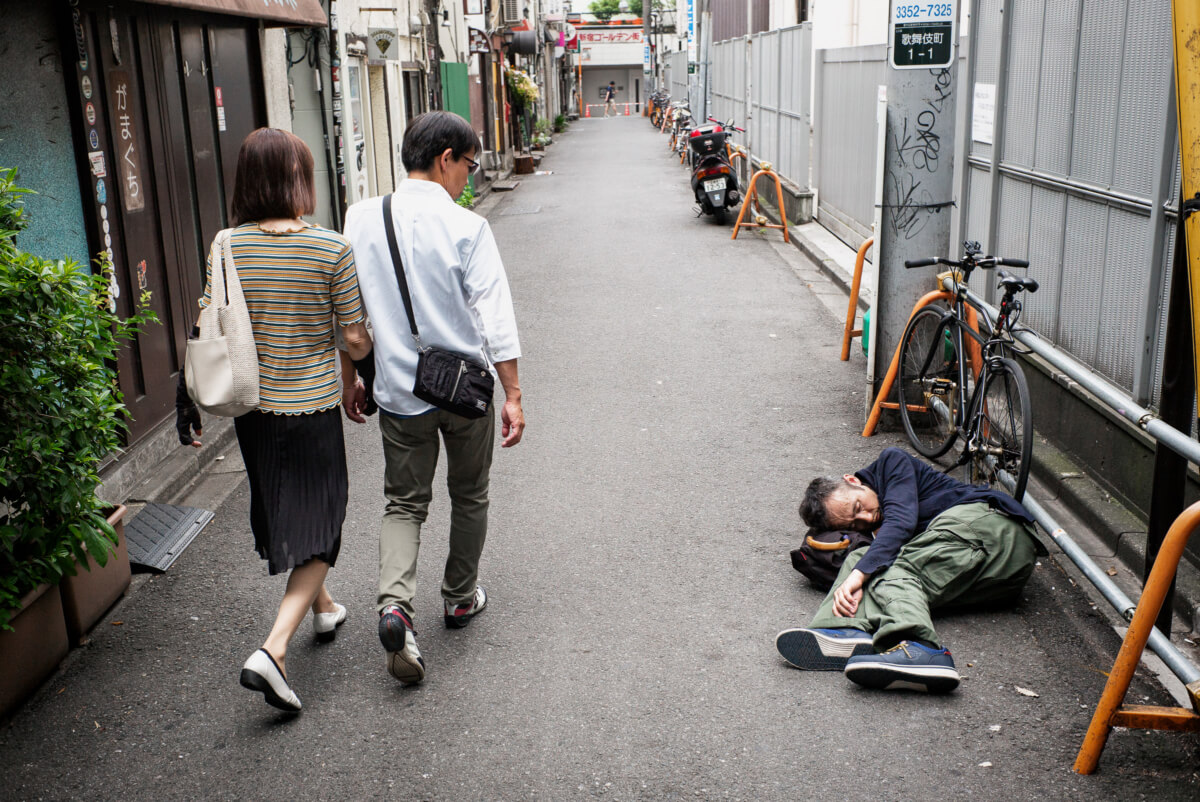 A Japanese man drunk and asleep in Tokyo
