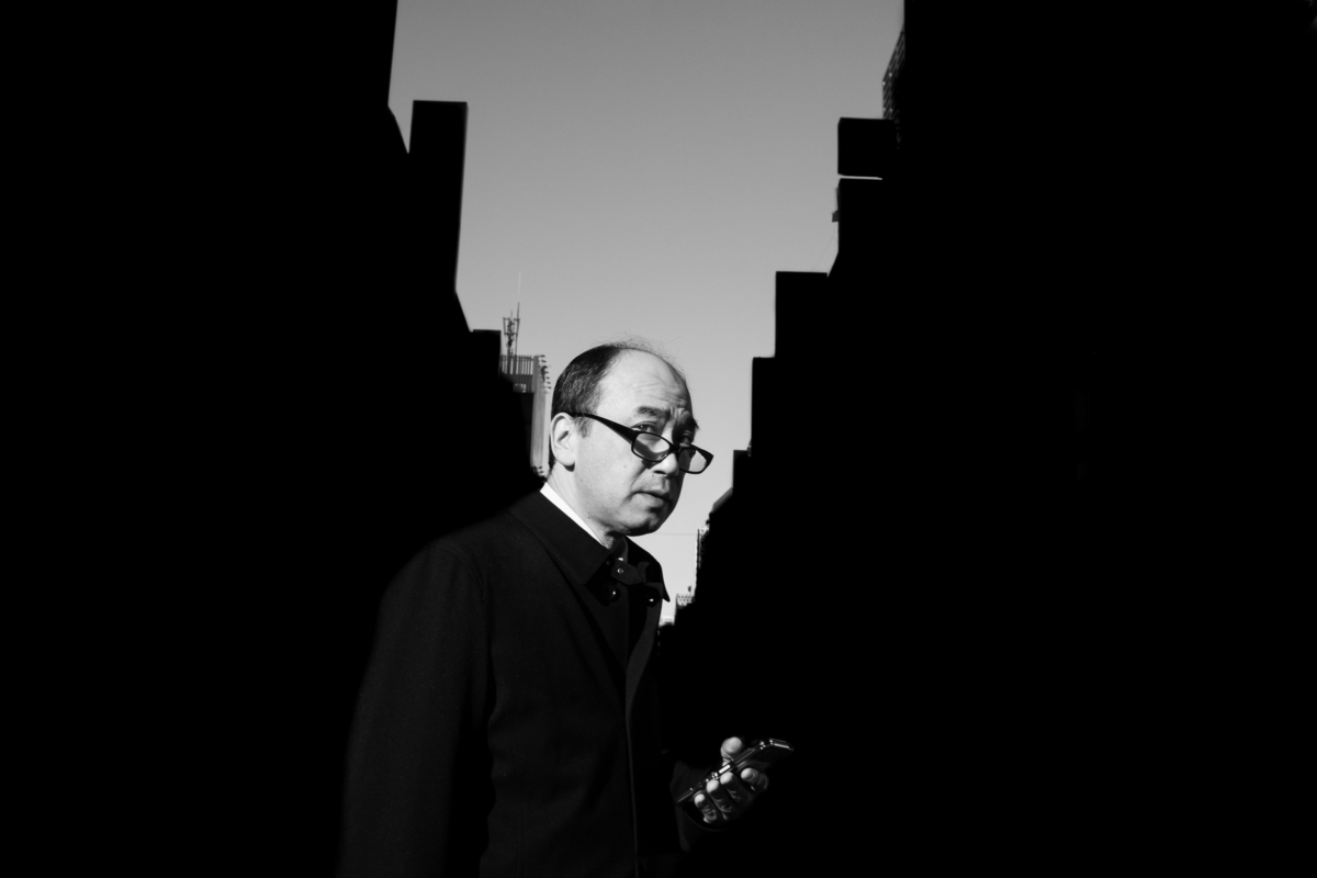 a Tokyo salaryman and the silhouettes of the city