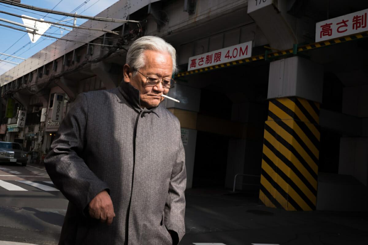an old Japanese man smoking