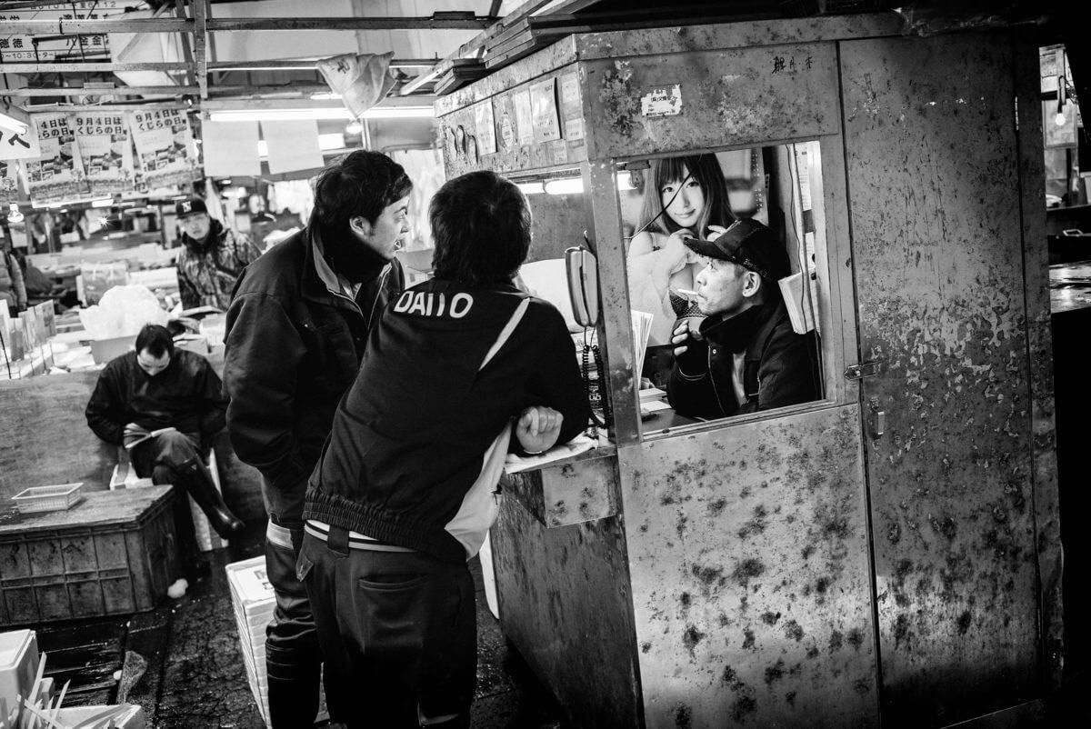 tsukiji fish market men and a woman